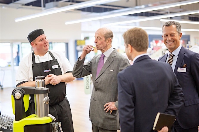 HRH samples a freshly produced juice using state of the art machinery at Nisbet Catering