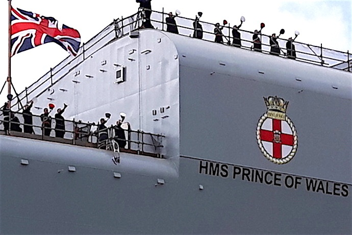 The crew of HMS PRINCE OF WALES give a 'hip, hip, hooray.'