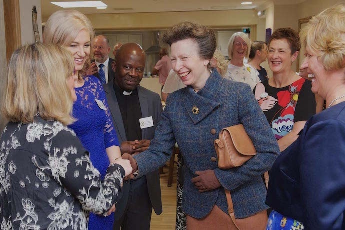 HRH shares a light moment with staff working at Griffiths House.